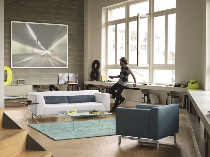 Moderner Farbmix mit Sofa und Sessel. ROLF BENZ Linea